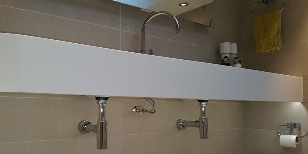 Bathroom sinks with chrome pipework